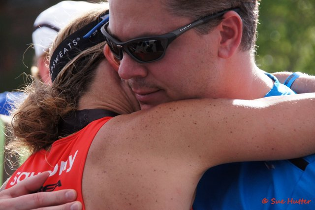 Meredith Kessler and husband Aaron Kessler hug finish line Ironman St. George