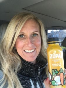 Meredith Kessler triathlete holding ZÜPA NOMA bottle Organic Carrot Coconut Lime