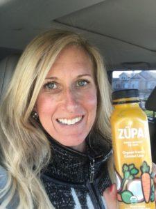 Meredith Kessler triathlete holding ZÜPA NOMA bottle Organic Carrot Coconut Lime