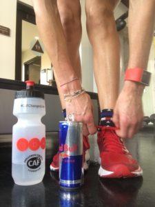 Meredith Kessler Red Bull Can tying shoe