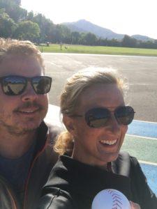 Meredith Kessler Triathlete With Husband Aaron Kessler Holding a Baseball