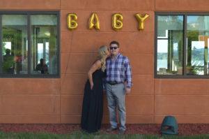 Meredith Kessler Triathlete Kissing Husband Announcing Baby Boy