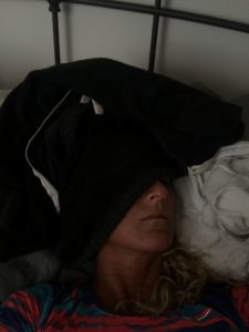 Meredith Kessler Triathlete Sleeping with Sweatshirt Covering Head