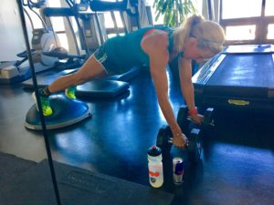 Meredith Kessler Triathlete Pushups in Gym with Red Bull
