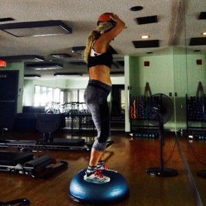 Meredith Kessler at gym bosu ball baby bump stomach