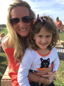 Meredith Kessler with friend's daughter in Ohio at birthday party