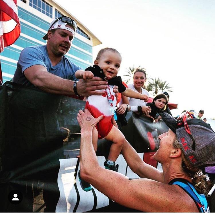 Meredith Kessler Triathlete Aaron Kessler husband handing son Mak
