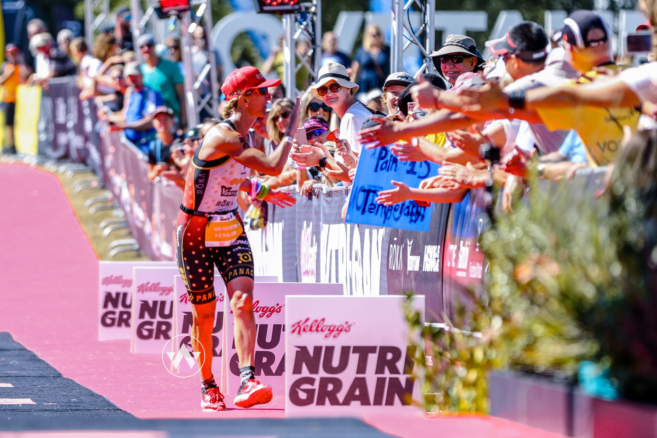 Meredith Kessler Professional Triathlete Finish Line 2019 Ironman New Zealand Finishing Chute Witsup Photo